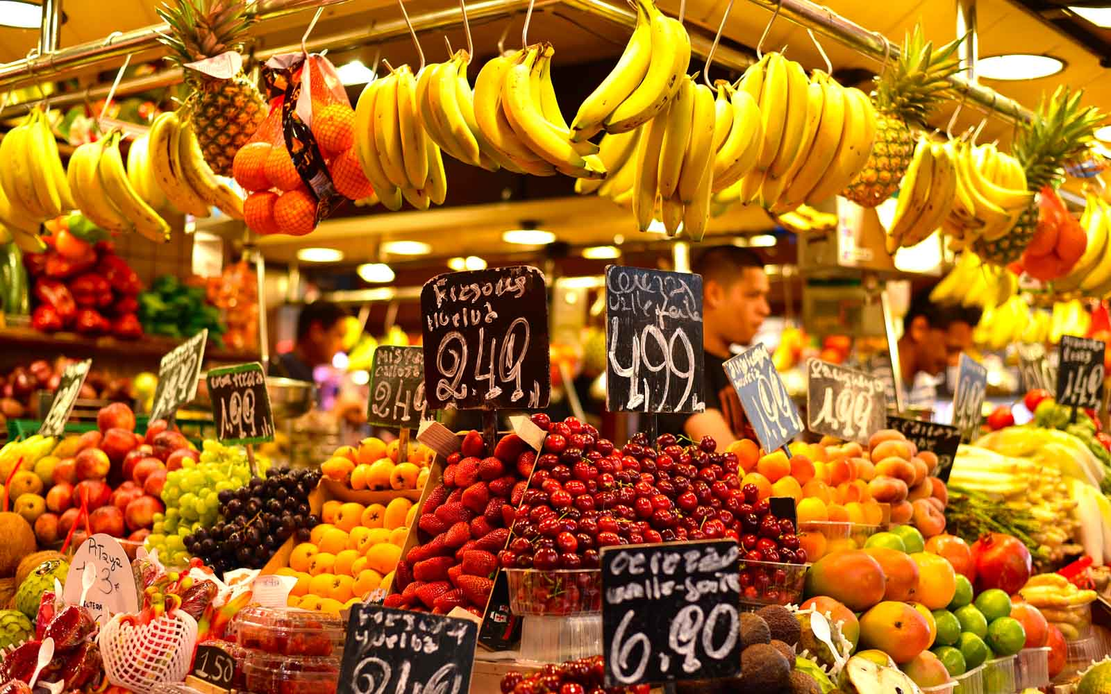 a fruit stand at boqueria market barcelona