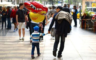 a man and a son walking down la rambla barcelona