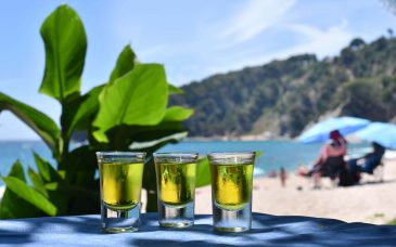three shots lined up at the beach near barcelona spain