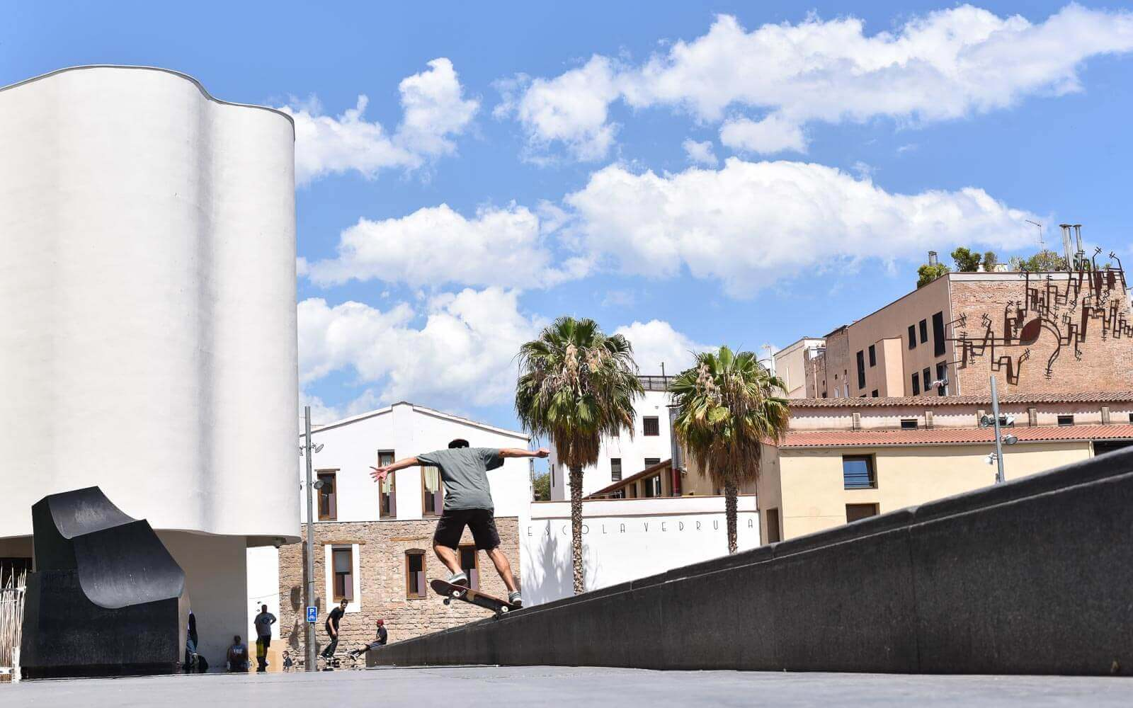 a skateboarder takes a jump at macba in raval neighbourhood barcelona