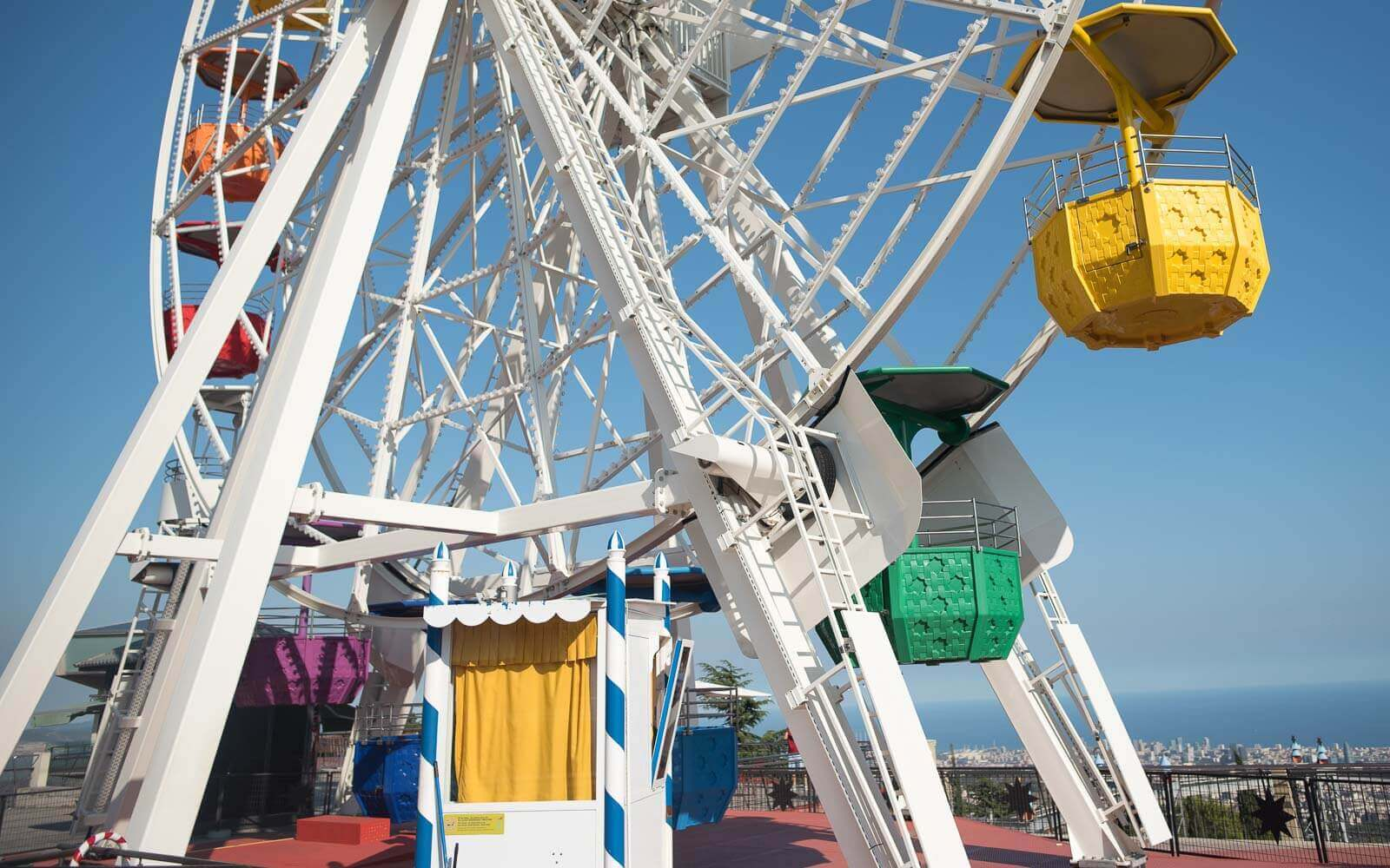a ferris wheel atop tibidabo amusement park barcelona