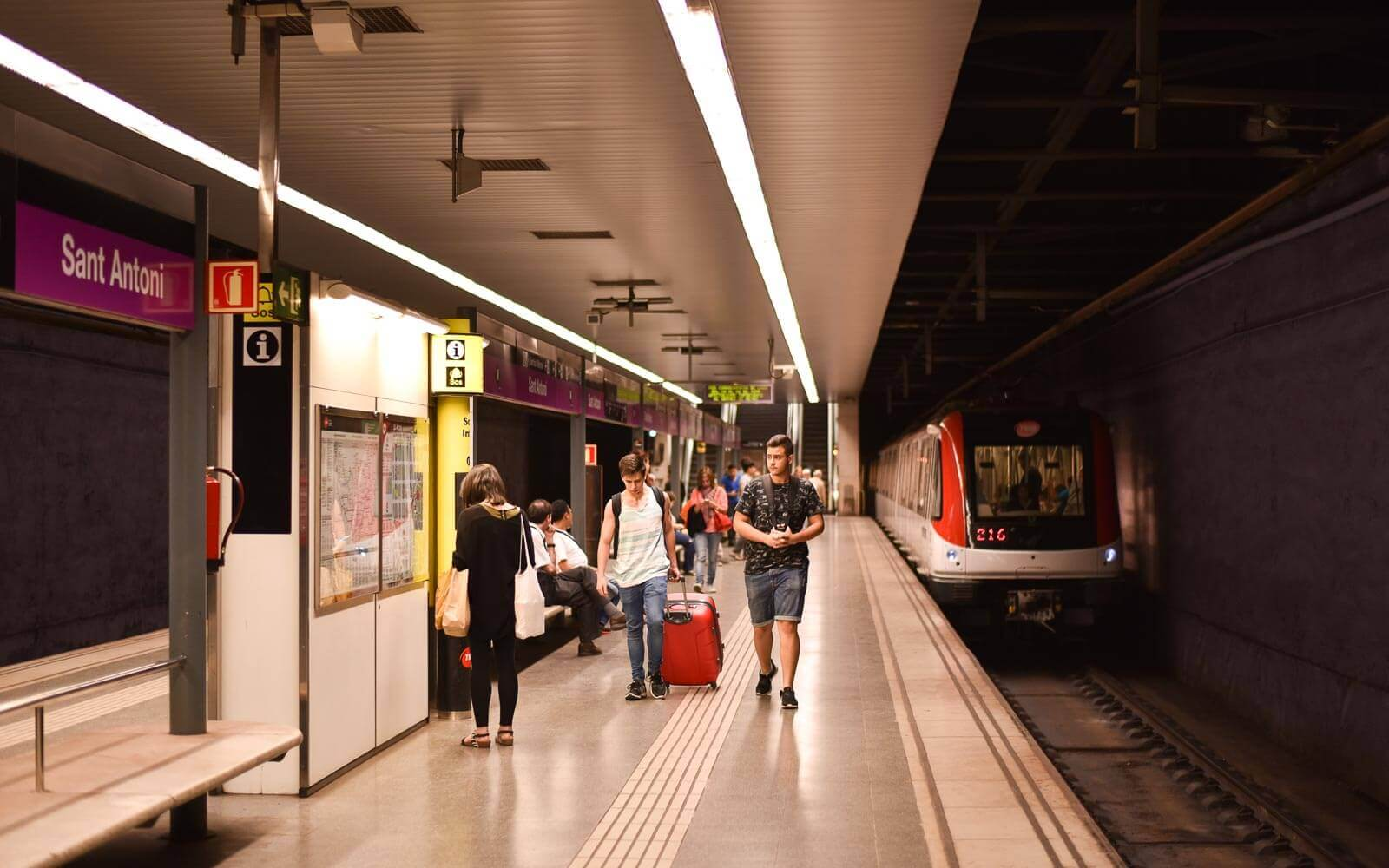 travellers use the metro in barcelona spain