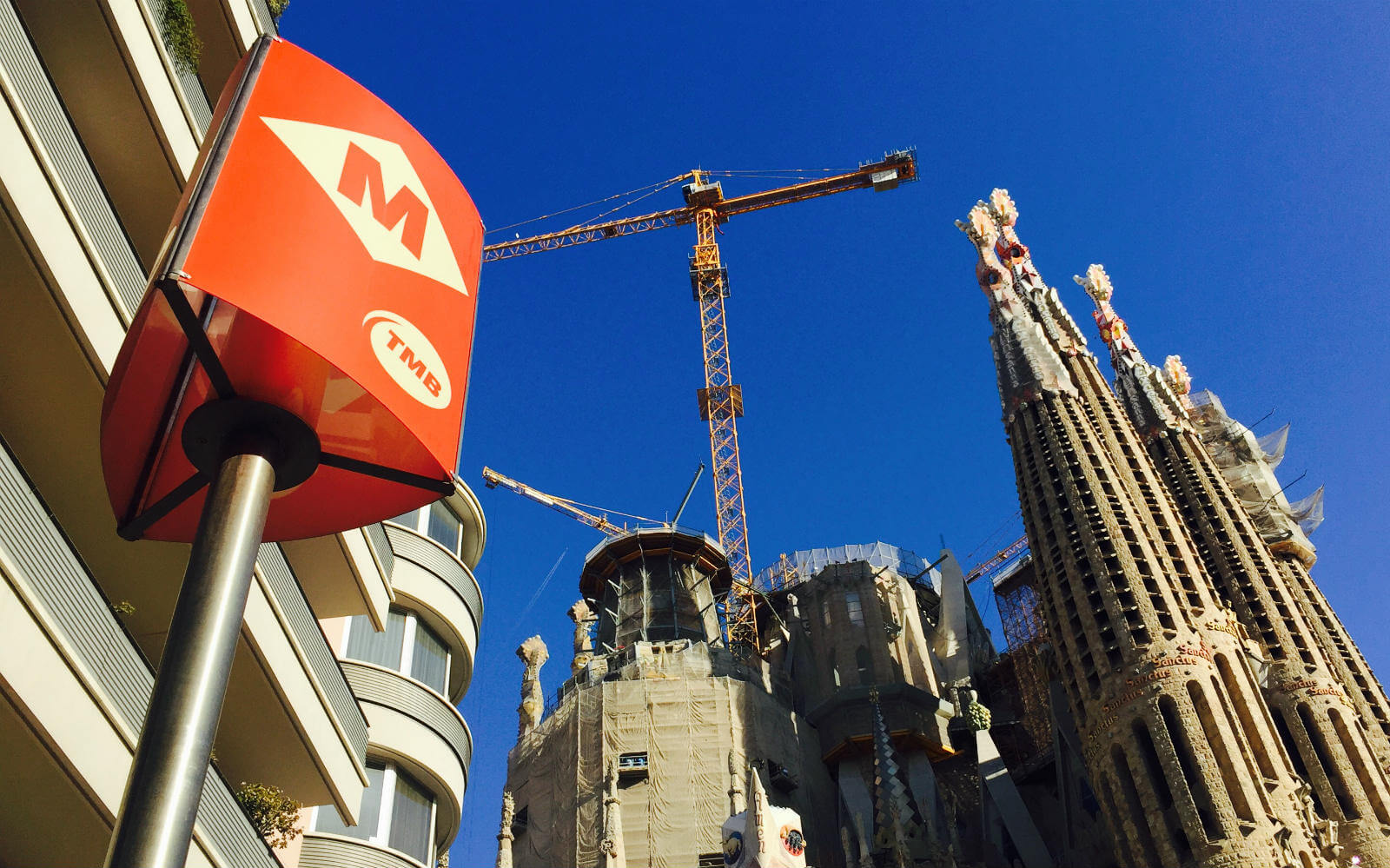 a barcelona metro stop sign at sagrada familia