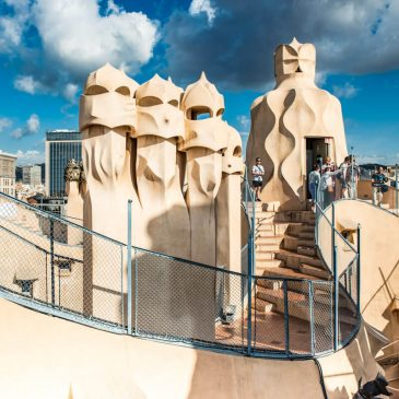 tourists exploring the roof terrace at casa mila la pedrera