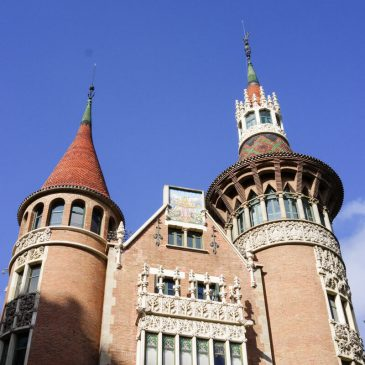 the main facade with two towers at casa de les punxes