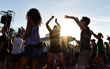 tourists dancing at an outdoor festival in barcelona spain