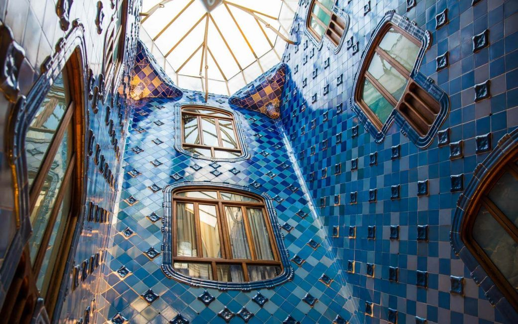 the brilliant blue interior stairwell at casa batllo barcelona