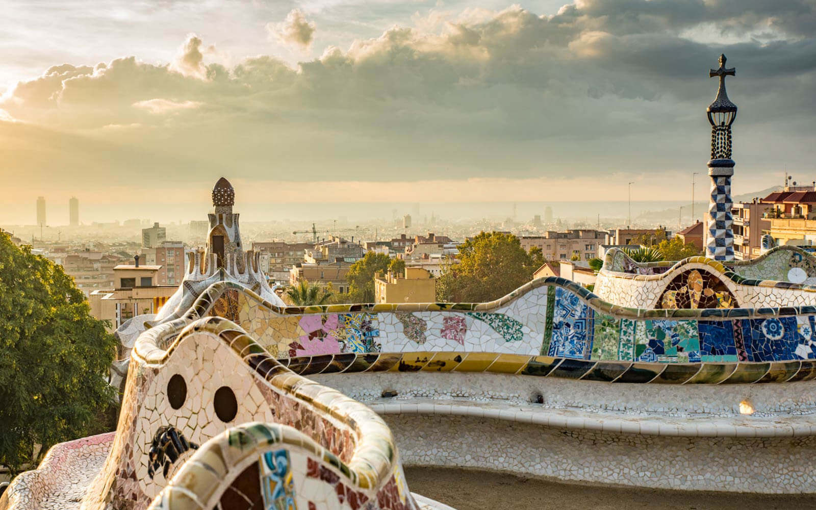 the view of the city and sea from the mosaic benches at park guell barcelona