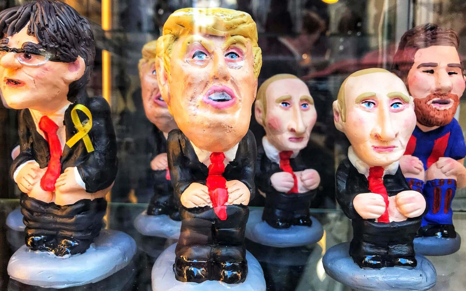 traditional barcelona souvenir caganer with trump, putin, messi, and puigmont