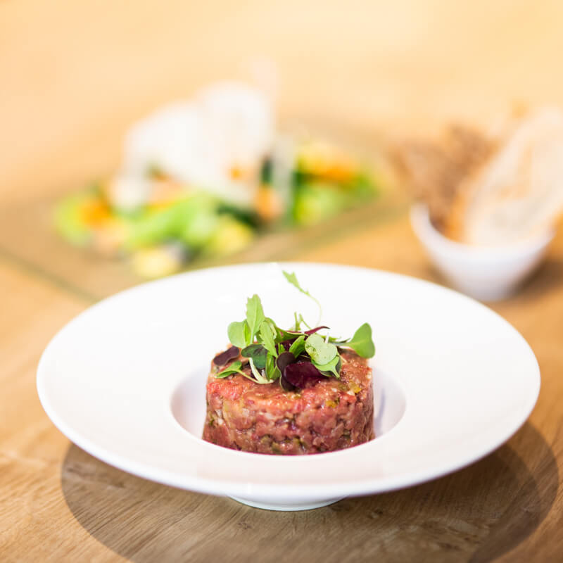 a beef tartare plate at season restaurant barcelona spain