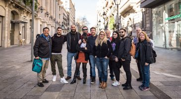 a group of tourists together on the secrets of the old city gothic quarter tour in barcelona spain