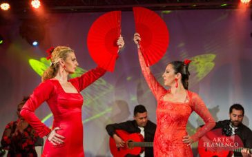 two flamenco dancers pose with fans at an arte flamenco performance in barcelona