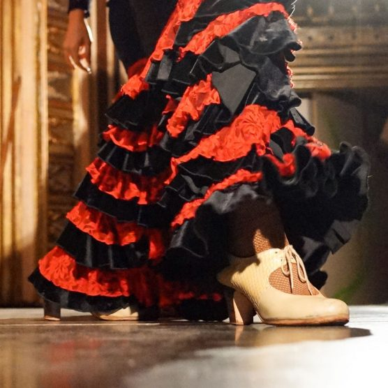 a flamenco dancer takes a dance step in barcelona spain