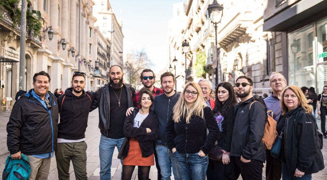 a group of tourists together on a barcelona walking tour called secrets of the old city with guide alvaro garza