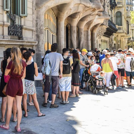 tourists lining up outside casa batllo in barcelona spain