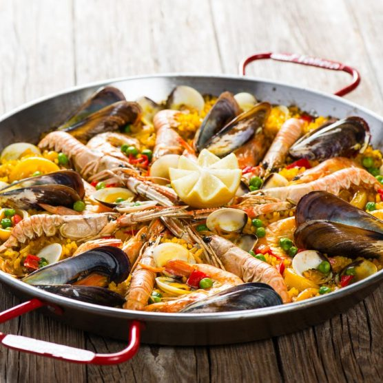 a pan of seafood paella at bodega joan restaurant in barcelona spain