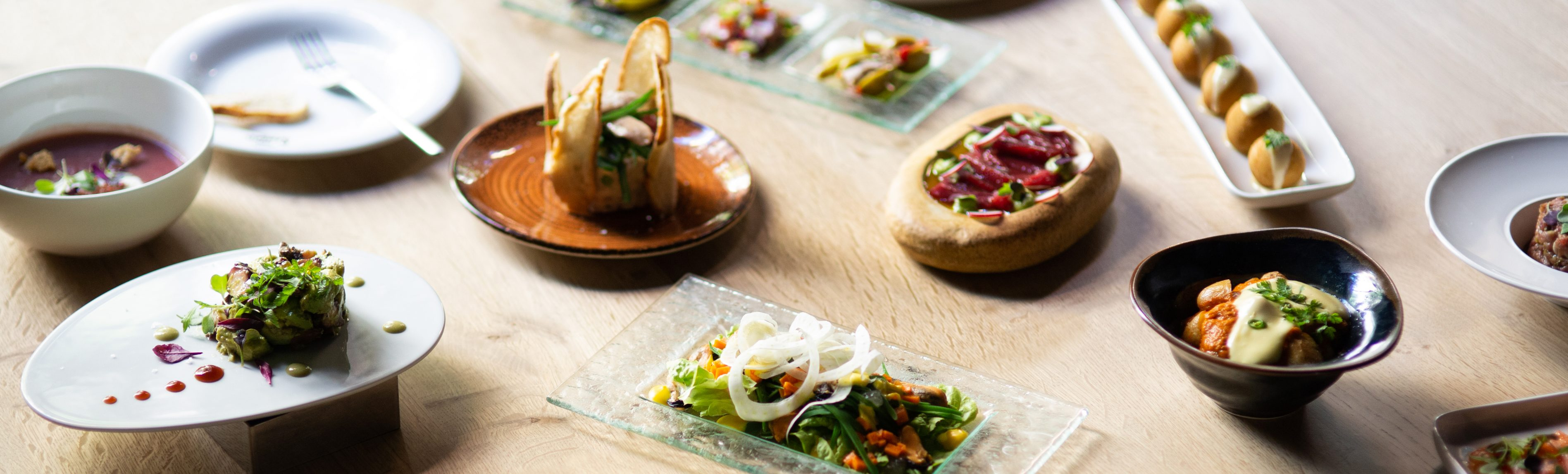 a spread of modern tapas at season restaurant in barcelona spain