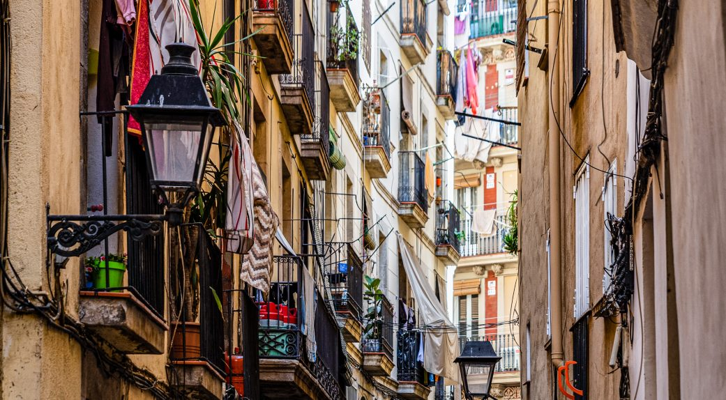 balconies with drying laundry hanging over the el born district of barcelona spain